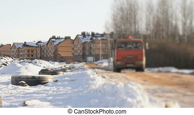 Truck transporting clay to construction site