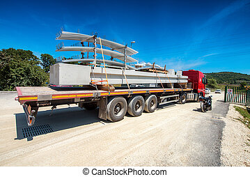 Truck transporting construction materials.