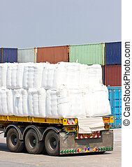 Truck transporting in port for cargo.
