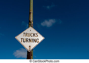Truck turning street sign