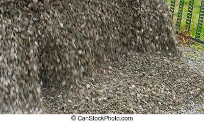 Truck unload crushed stone. - Dump truck crushed stone...