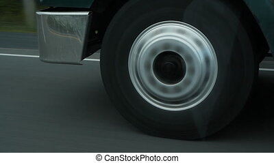 Truck wheel. - Closeup of a truck wheel on the highway. ...