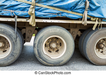 Truck Wheels Closeup Photo on the road.
