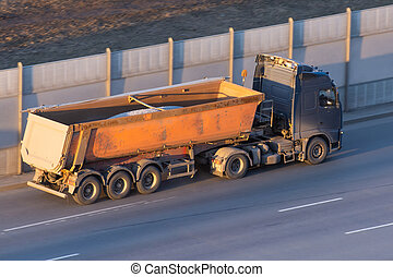 Truck with a trailer for bulk driving on the highway