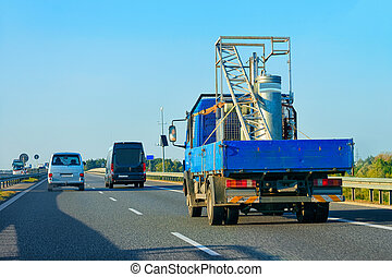Truck with storage tanker highway road in Slovenia