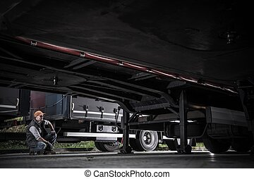 Trucker Checking Trailers