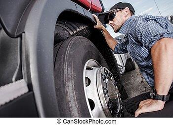 Trucker Making Tire Check