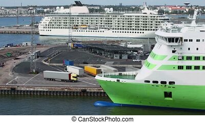 Trucks and cars ride through customs in port with ferry boat...