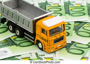 trucks and euro banknotes money - a truck and eurgeld ...