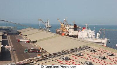 trucks and ship in seaport in Abu Dhabi, UAE - trucks and...