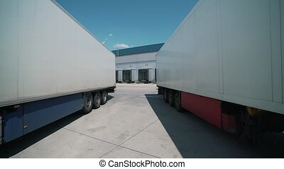 trucks are parked for unloading at the logical center.
