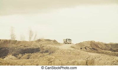 Trucks driving on a road in quarry