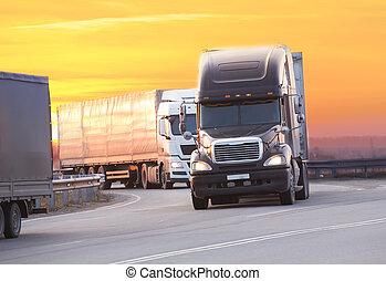 trucks goes on highway on sunset - trucks goes on highway in...