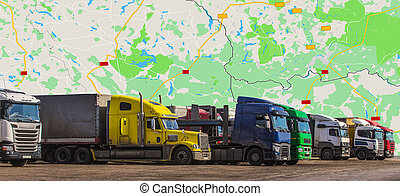 Trucks in front of a geographic map.