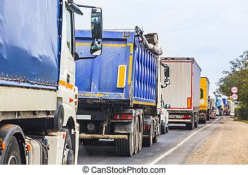 trucks in traffic jam on the road