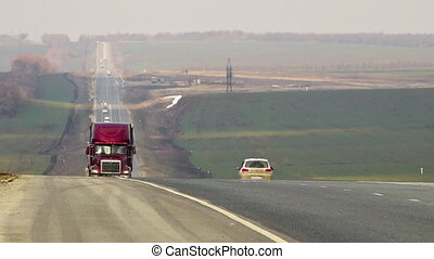 Trucks on a highway - A steady shot of trucks driving on a...