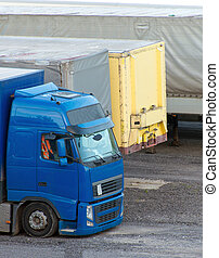 Trucks parked on a parking lot.