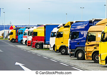 trucks parking on - many different trucks parked in a...