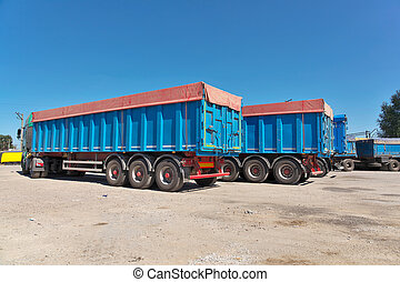 Trucks with grain waiting for the unloading the elevator