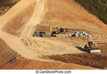 Trucks working on a dam?s construction