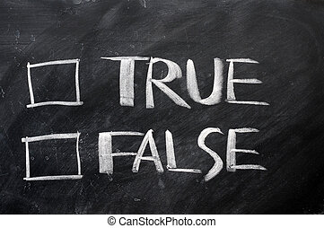 True and false check boxes written with chalk on a...