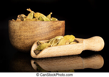 True cardamom pod isolated on black glass