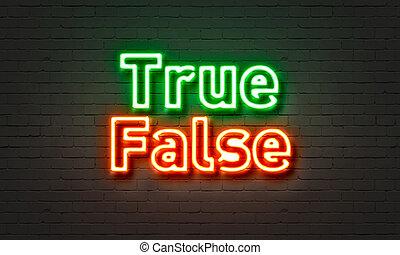 True false neon sign on brick wall background