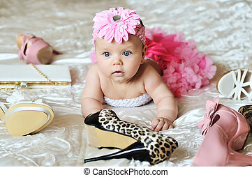 true fashion - baby girl wearing tutu laying on the bed with...
