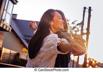 Joyful happy woman holding hands of her boyfriend