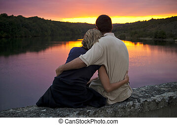 True romance - A couple gently embrace as the sun sets