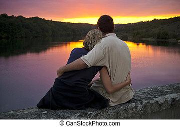 True romance - A couple gently embrace as the sun sets