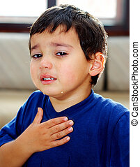 True tears and true emotions - A little boy crying and...
