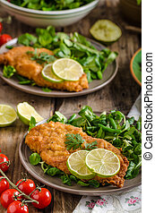 True Viennese schnitzel with little salad and lime, french ...