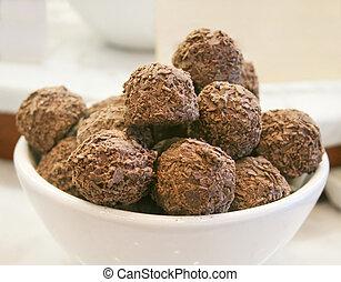 Truffles - Dark chocolate truffles in the white bowl