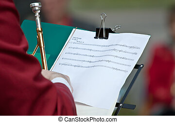 Trumpet player and his notes