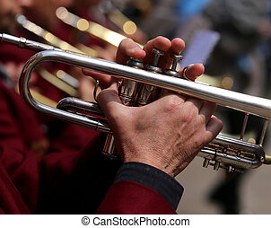 trumpet player during an outdoor exhibition of a brass band