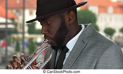 Trumpet player in the street.