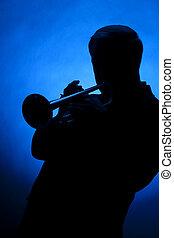Trumpet Player Silhouette Against Blue Spot Light - A ...