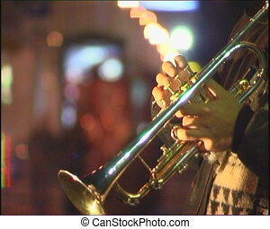 Trumpet player. - Playing jazz on streets.