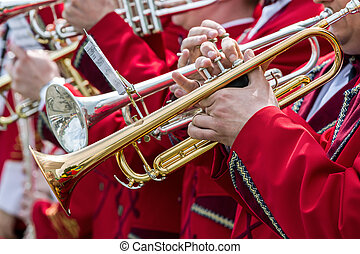 trumpet players at music festival of street brass bands