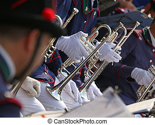 Trumpet players in the band during a performance