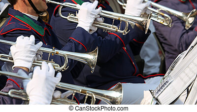 Trumpet players in the orchestra during a performance