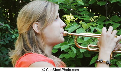 Trumpet. Stop-motion effect. - Female musician playing a...