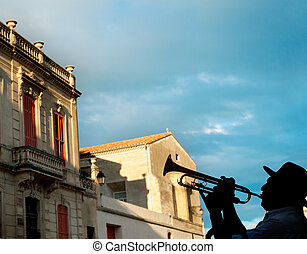 Silhouette of a trumpeter on Arles street, France