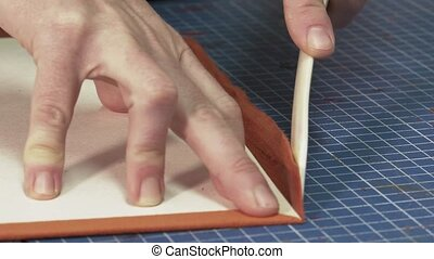 Trunk Maker at work in his workshop - folding and gluing...