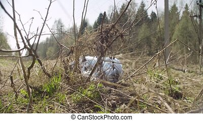 Trush bag lying in the forest. Social irresponsibility. Save...