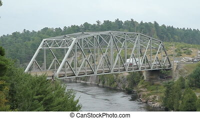 Truss bridge over the French river. - Steel Pratt truss...