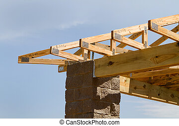 Truss Roof Construction - Manufactured truss rafters are...
