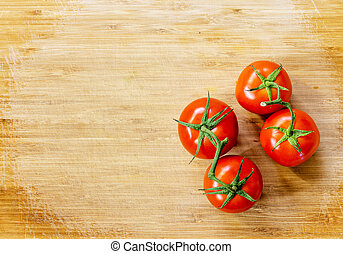 Truss Tomatoes On Wooden Background
