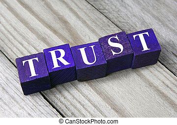 trust concept- word on wooden cubes